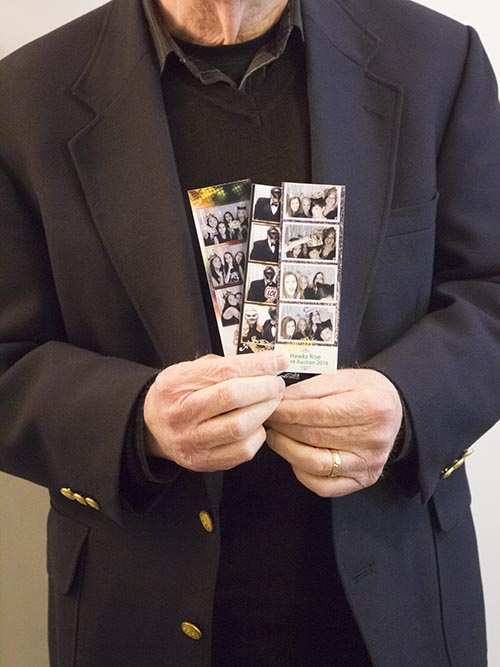 Person holding photo strips