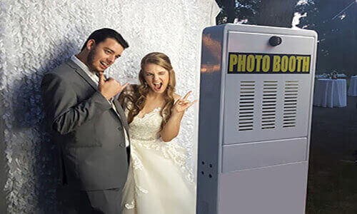 Bride and Groom looking at the Photo Booth.