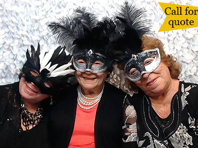 three older ladies pose with masks in the photo booth