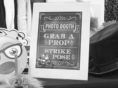a sign welcomes guests to the photo booth