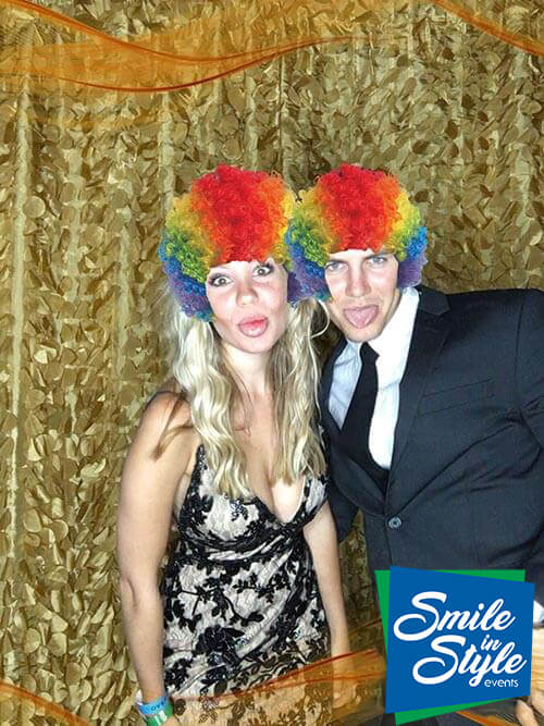 Two people having fun at the Social Photo Booth.